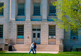 Students Walking Across Parker Hall on South Campus in Spring